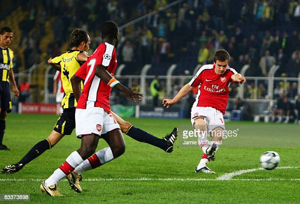 Aaron Ramsey scores for Arsenal during the UEFA Champions League Group G match between Fenerbahce and Arsenal at the Sukru Saracoglu Stadium on...