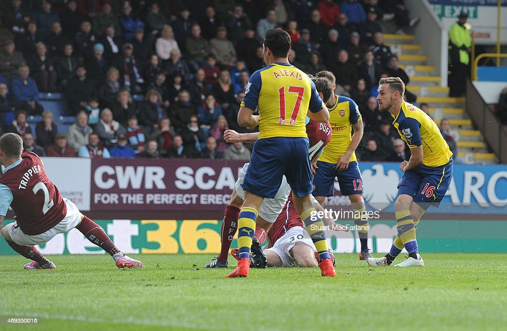 Aaron Ramsey scores the Arsenal goal during the Barclays Premier League match between Burnley and Arsenal at Turf Moor on April 11, 2015 in Burnley, England.