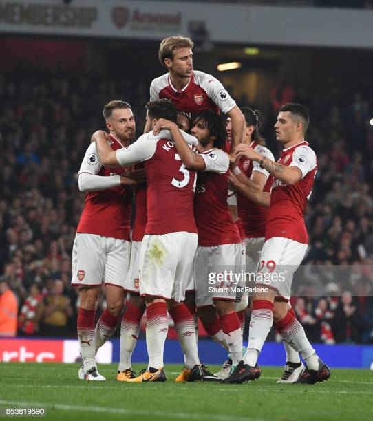Aaron Ramsey Sead Kolasinac Nacho Monreal Mohamed Elneny and Granit Xhaka celebrate the 2nd Arsenal goal score by Alex Lacazette during the Premier...