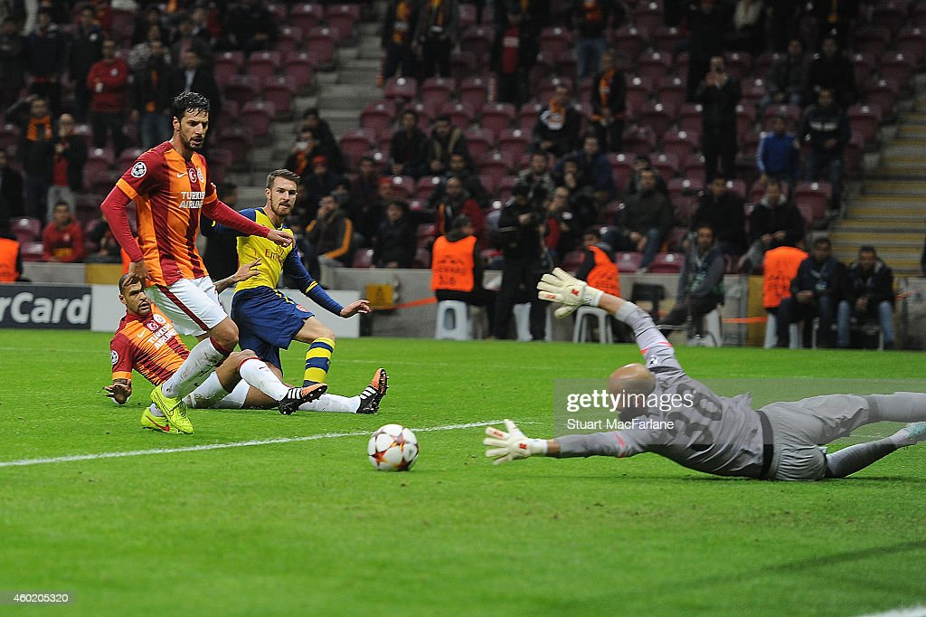 Aaron Ramsey shoots past Galatasarary goalkeeper Sinan Bolat to score the 2nd Arsenal goal during the UEFA Champions League match between Galatasaray and Arsenal at the Turk Telekom Arena on December 9, 2014 in Istanbul, Turkey.
