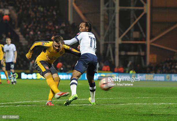 Aaron Ramsey shoots past Preston's Daniel Johnson to score the 1st Arsenal goal during the Emirates FA Cup Third Round match between Preston North...