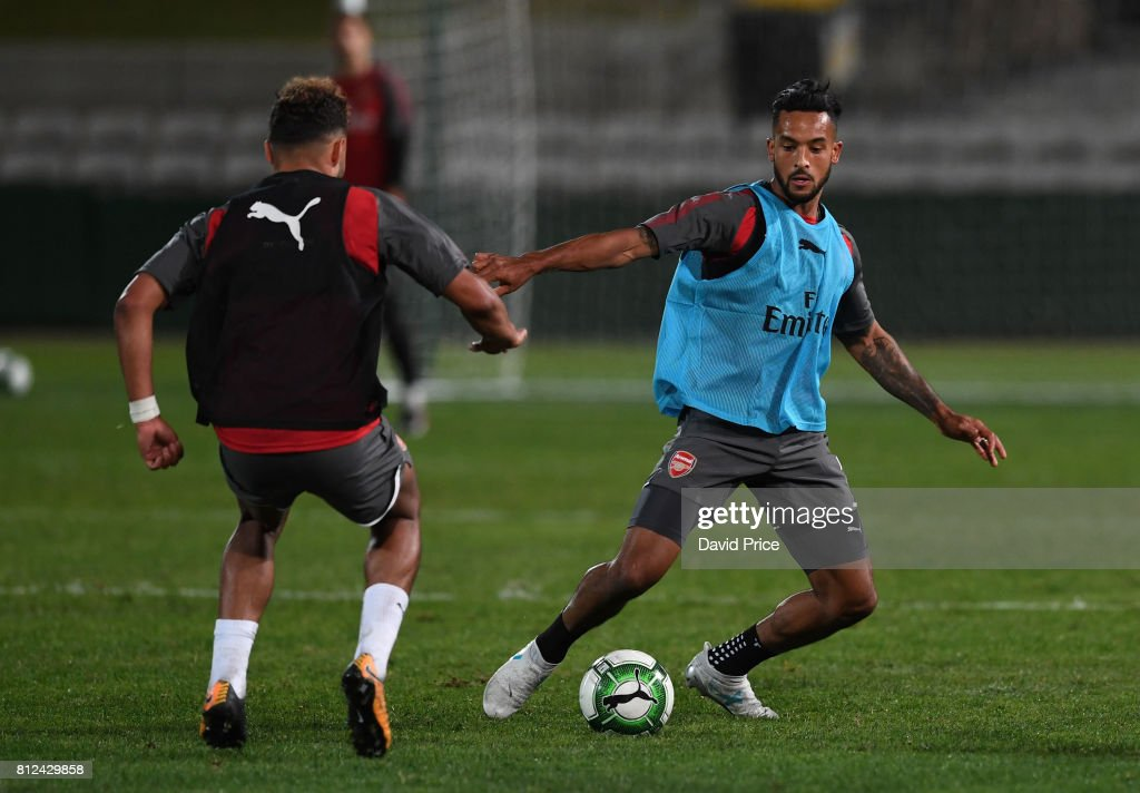 Aaron Ramsey takes on Alex Oxlade-Chamberlain of Arsenal during the Arsenal Training Session at Koragah Oval on July 11, 2017 in Sydney, Australia.