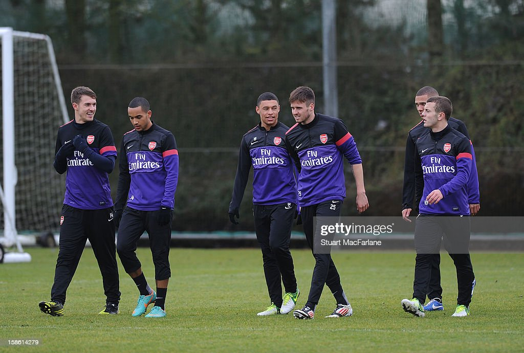 Aaron Ramsey, Theo Walcott, Alex Oxlade-Chamberlain, Carl Jenkinson, Kieran Gibbs and Jack Wilshere of Arsenal during a training session at London Colney on December 21, 2012 in St Albans, England.