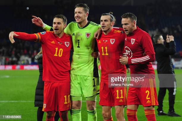 Aaron Ramsey, Wayne Hennessey, Gareth Bale and Chris Gunter of Wales celebrate at full time during the UEFA Euro 2020 Group E Qualifier match between...