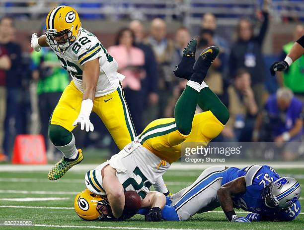 Aaron Ripkowski of the Green Bay Packers is tackled by Tavon Wilson of the Detroit Lions during first quarter action at Ford Field on January 1 2017...