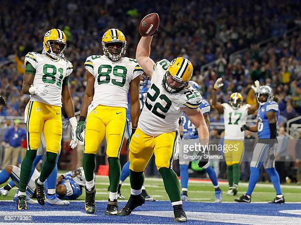 Aaron Ripkowski of the Green Bay Packers spikes the ball after scoring a touchdown against the Detroit Lions during second quarter action at Ford...