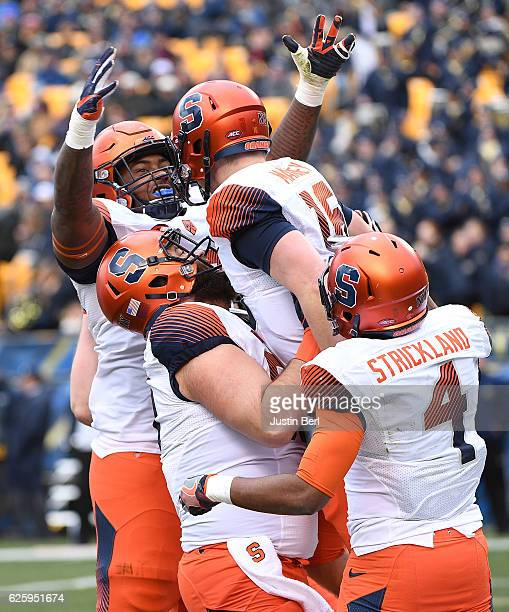 Aaron Roberts of the Syracuse Orange reacts as Zack Mahoney is lifted in the air after rushing for a 2 yard touchdown in the first quarter during the...