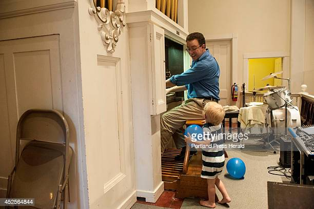 Aaron Robinson helps to restore an organ at Damariscotta Baptist Church on Tuesday July 15 2014