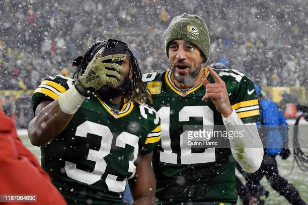 Aaron Rodgers and Aaron Jones of the Green Bay Packers react after the win against the Carolina Panthers at Lambeau Field on November 10 2019 in...