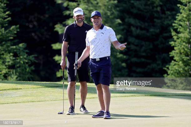Aaron Rodgers and Bryson DeChambeau react during Capital One's The Match at The Reserve at Moonlight Basin on July 06, 2021 in Big Sky, Montana.