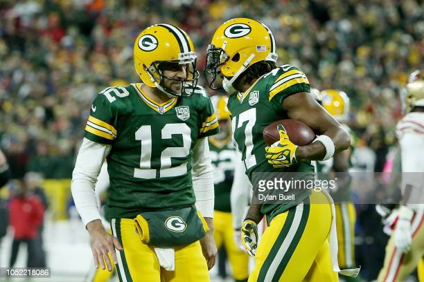 Aaron Rodgers and Davante Adams of the Green Bay Packers celebrate after scoring a touchdown in the first quarter against the San Francisco 49ers at...