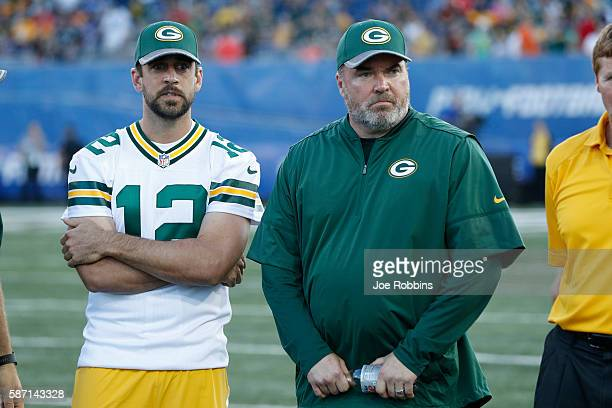 Aaron Rodgers and head coach Mike McCarthy of the Green Bay Packers look on after the NFL Hall of Fame Game against the Indianapolis Colts was...