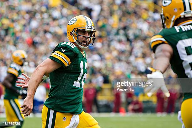 Aaron Rodgers and Jermichael Finley of the Green Bay Packers celebrate after a touchdown against the Washington Redskins at Lambeau Field on...