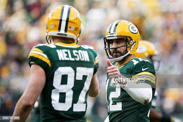 Aaron Rodgers and Jordy Nelson of the Green Bay Packers celebrate after scoring a touchdown in the fourth quarter against the Minnesota Vikings at...