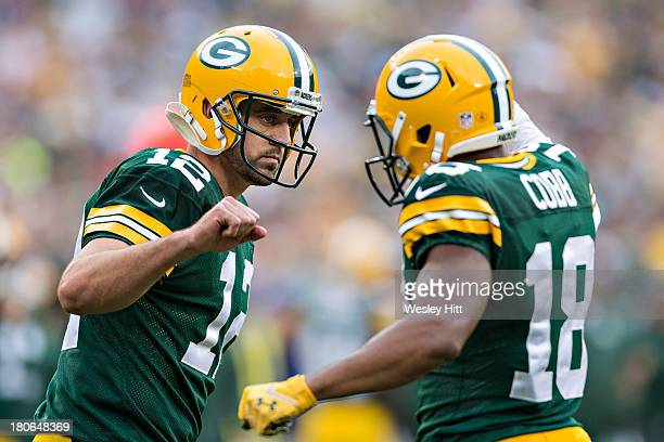 Aaron Rodgers and Randall Cobb of the Green Bay Packers celebrate after a touchdown against the Washington Redskins at Lambeau Field on September 15...