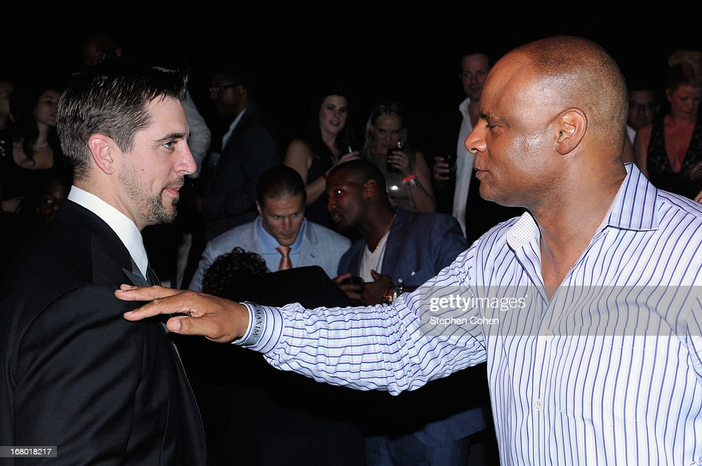 Aaron Rodgers and Warren Moon attends the Maxim And Maker's 46 Fillies & Stallions Hosted By Blackrock at Mellwood Arts & Entertainment Center on May 3, 2013 in Louisville, Kentucky.