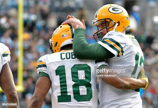 Aaron Rodgers celebrates with teammate Randall Cobb of the Green Bay Packers after a touchdown against the Carolina Panthers in the second quarter...