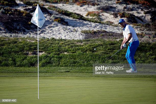 Aaron Rodgers chips onto the third green during the first round of the ATT Pebble Beach National ProAm at the Spyglass Hill Golf Course on on...
