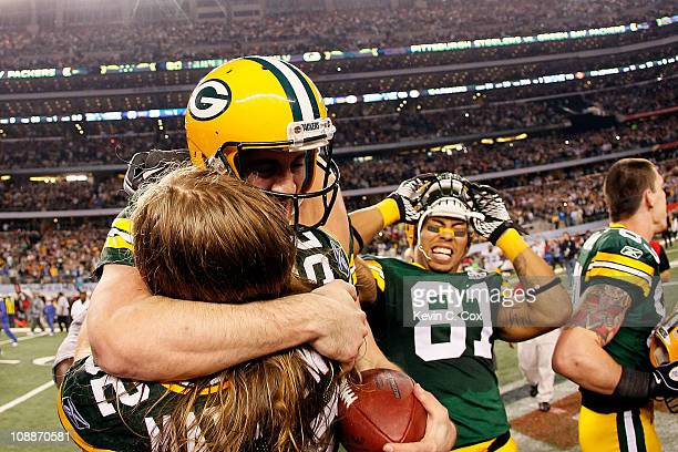 Aaron Rodgers hugs Clay Matthews of the Green Bay Packers as Andrew Quarless looks on after winning Super Bowl XLV 31-25 against the Pittsburgh...