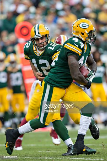 Aaron Rodgers makes a hand off to James Starks of the Green Bay Packers during a game against the Washington Redskins at Lambeau Field on September...