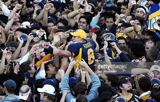 Aaron Rodgers of the California Golden Bears celebrates with fans after defeating the Stanford Cardinals on November 20, 2004 at Memorial Stadium in...