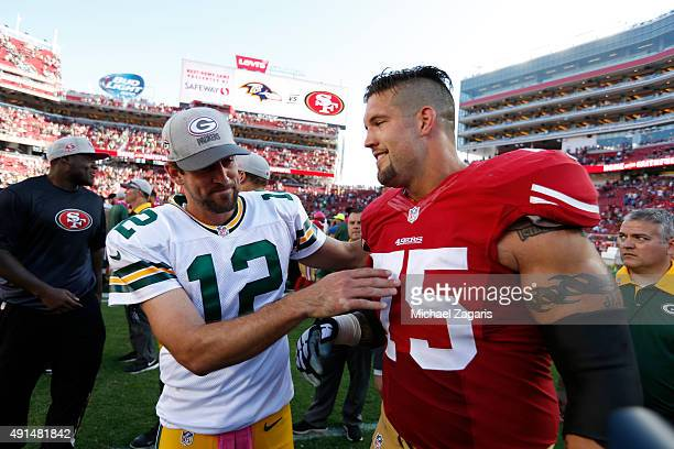 Aaron Rodgers of the Green Bay Packers and Alex Boone of the San Francisco 49ers talk on the field following the game at Levi Stadium on October 4...