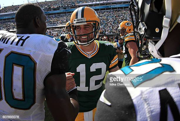Aaron Rodgers of the Green Bay Packers and Telvin Smith of the Jacksonville Jaguars shake hands during a game at EverBank Field on September 11 2016...
