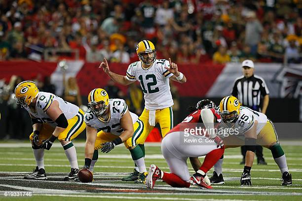 Aaron Rodgers of the Green Bay Packers calls a play against the Atlanta Falcons at Georgia Dome on October 30 2016 in Atlanta Georgia