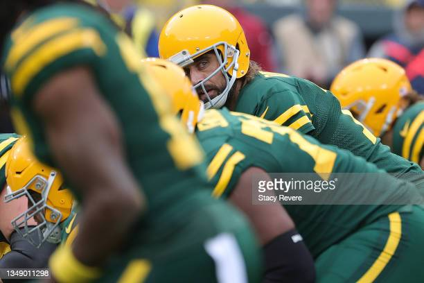 Aaron Rodgers of the Green Bay Packers calls a play at the line of scrimmage during a game against the Washington Football Team at Lambeau Field on...
