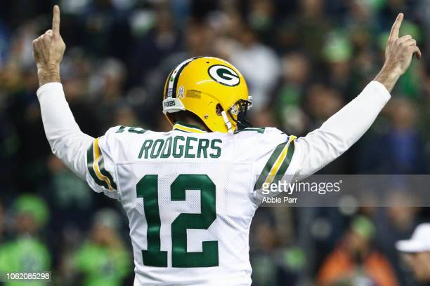 Aaron Rodgers of the Green Bay Packers celebrates a touchdown in the first quarter against the Seattle Seahawks at CenturyLink Field on November 15...