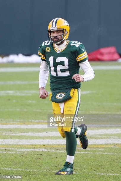 Aaron Rodgers of the Green Bay Packers celebrates a touchdown in the second quarter against the Tampa Bay Buccaneers during the NFC Championship game...