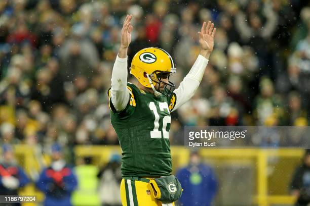Aaron Rodgers of the Green Bay Packers celebrates a touchdown scored by Aaron Jones against the Carolina Panthers during the second quarter in the...