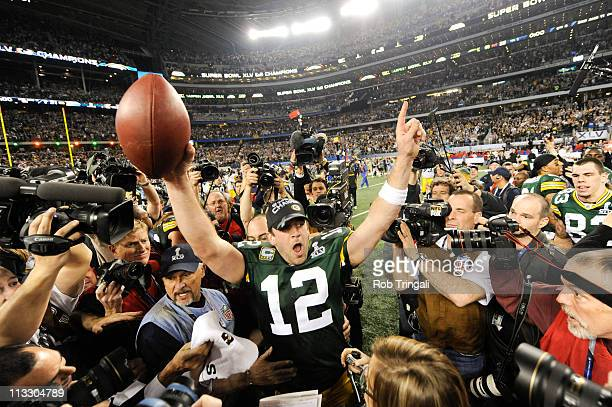 Aaron Rodgers of the Green Bay Packers celebrates after defeating the Pittsburgh Steelers in Super Bowl XLV on February 6 2011 at Cowboys Stadium in...