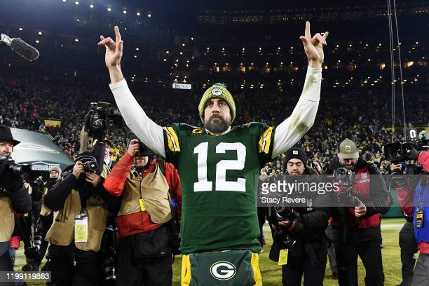 Aaron Rodgers of the Green Bay Packers celebrates after defeating the Seattle Seahawks 28-23 in the NFC Divisional Playoff game at Lambeau Field on...