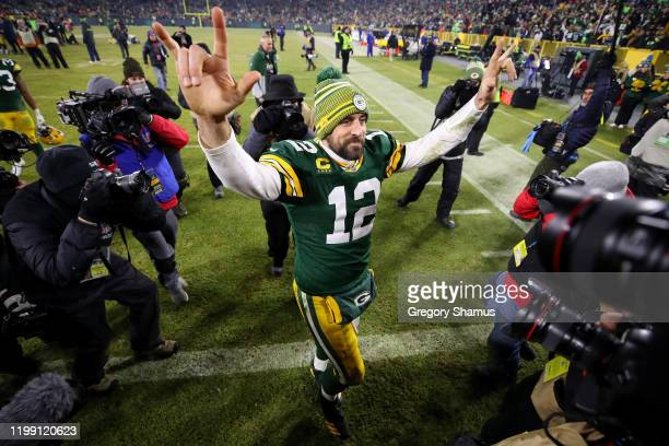 Aaron Rodgers of the Green Bay Packers celebrates after defeating the Seattle Seahawks 2823 in the NFC Divisional Playoff game at Lambeau Field on...