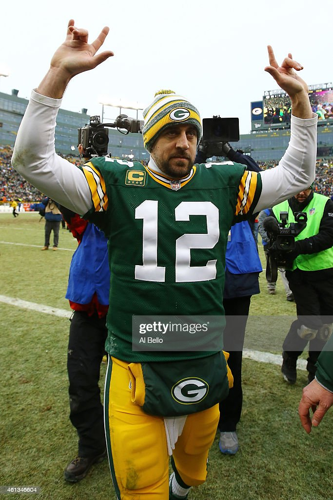 Aaron Rodgers #12 of the Green Bay Packers celebrates after defeating the Dallas Cowboys 26-21 during the 2015 NFC Divisional Playoff game at Lambeau Field on January 11, 2015 in Green Bay, Wisconsin.