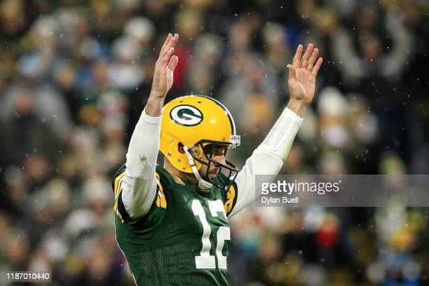 Aaron Rodgers of the Green Bay Packers celebrates after scoring a touchdown in the second quarter against the Carolina Panthers at Lambeau Field on...