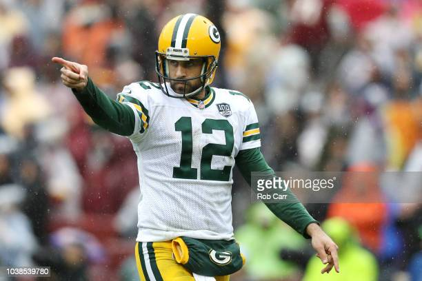Aaron Rodgers of the Green Bay Packers celebrates after throwing a second quarter touchdown pass against the Washington Redskins at FedExField on...