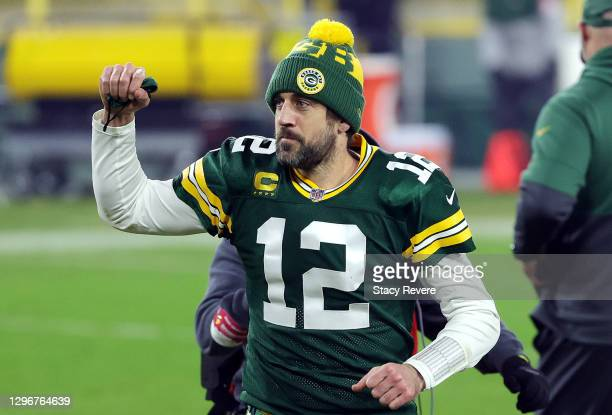 Aaron Rodgers of the Green Bay Packers celebrates defeating the Los Angeles Rams 32-18 in the NFC Divisional Playoff game at Lambeau Field on January...