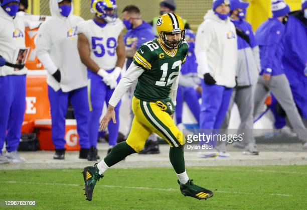 Aaron Rodgers of the Green Bay Packers celebrates throwing a touchdown pass to Allen Lazard in the fourth quarter against the Los Angeles Rams during...