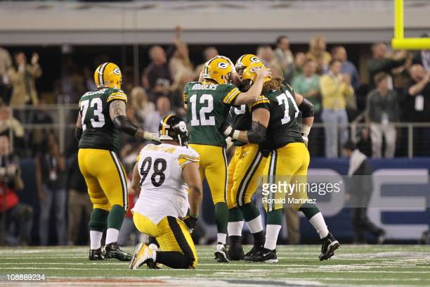 Aaron Rodgers of the Green Bay Packers celebrates with teammates as Casey Hampton of the Pittsburgh Steelers looks on after Jordy Nelson of the Green...