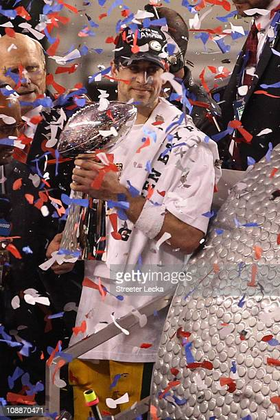 Aaron Rodgers of the Green Bay Packers celebrates with the Lombardi Trophy after winning Super Bowl XLV against the Pittsburgh Steelers at Cowboys...