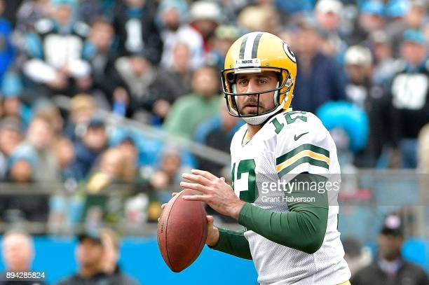Aaron Rodgers of the Green Bay Packers drops back to pass against the Carolina Panthers during their game at Bank of America Stadium on December 17...