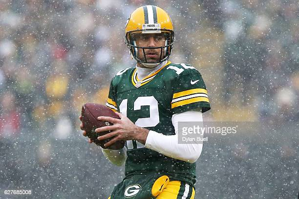 Aaron Rodgers of the Green Bay Packers drops back to pass in the first quarter against the Houston Texans at Lambeau Field on December 4 2016 in...