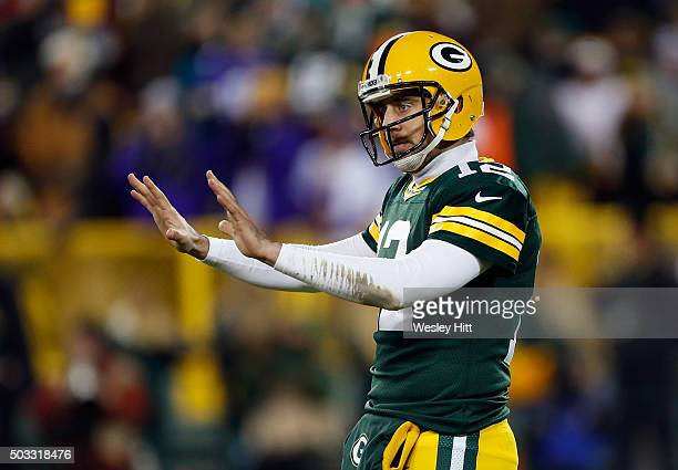 Aaron Rodgers of the Green Bay Packers gestures during the third quarter against the Minnesota Vikings at Lambeau Field on January 3 2016 in Green...