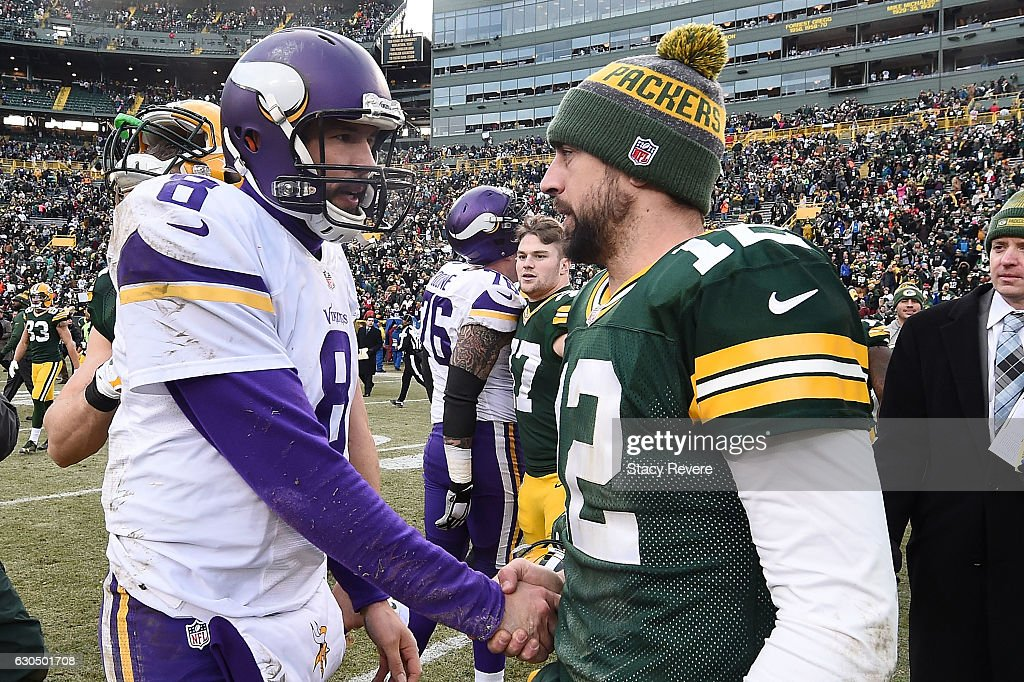 Aaron Rodgers #12 of the Green Bay Packers greets Sam Bradford #8 of the Minnesota Vikings at midfield after a game at Lambeau Field on December 24, 2016 in Green Bay, Wisconsin. The Packers defeated the Vikings 38-25.