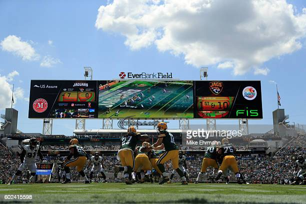 Aaron Rodgers of the Green Bay Packers hands off to Eddie Lacy during the game against the Jacksonville Jaguars at EverBank Field on September 11...