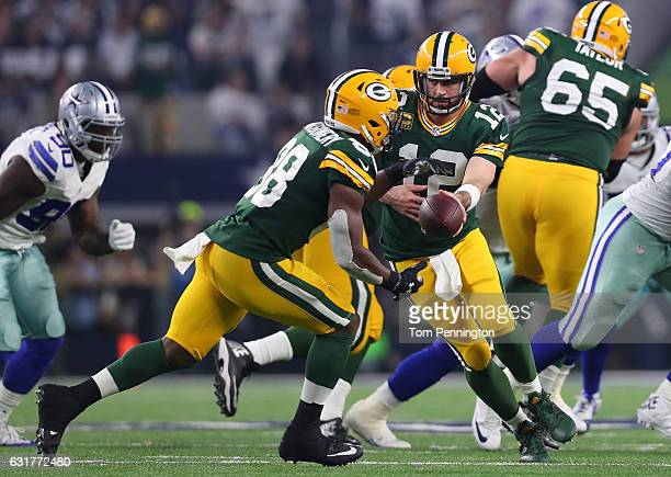 Aaron Rodgers of the Green Bay Packers hands off to Ty Montgomery during the third quarter in the NFC Divisional Playoff game at ATT Stadium on...