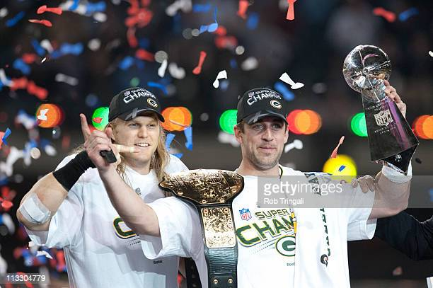 Aaron Rodgers of the Green Bay Packers holds up the Vince Lombardi Trophy as Clay Matthews looks on after defeating the Pittsburgh Steelers in Super...