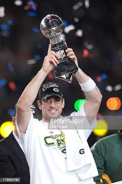 Aaron Rodgers of the Green Bay Packers holds up the Vince Lombardi Trophy after defeating the Pittsburgh Steelers in Super Bowl XLV on February 6...
